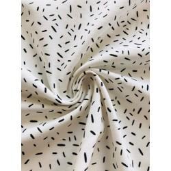 Jersey motif confetti blanc x 50cm