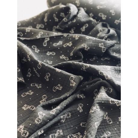 Tissu triple gaze noire motif girafe x 50cm